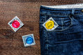 Safe Sex With Condom Contraception In Jeans Pocket On Wooden Background Top View Stock Photo - 93331420