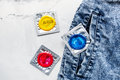 Male Contraception And Jeans With Condom On White Background Top View Royalty Free Stock Image - 93331426
