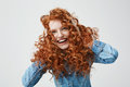 Portrait Of Cute Happy Girl Smiling Touching Her Curly Red Hair Over White Background. Stock Image - 93331561