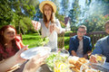 Happy Friends Having Dinner At Summer Garden Party Royalty Free Stock Photography - 93402367