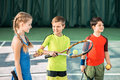 Happy Children Playing Tennis On Playground Royalty Free Stock Images - 93415759
