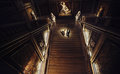 Spotlight Illuminates A Wedding Couple Going Downstairs In A Dar Royalty Free Stock Photo - 93417815