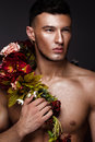 A Handsome Man With A Naked Torso, Bronze Tan And Flowers On His Body. Stock Image - 93463271