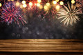 Empty Wooden Table In Front Of Fireworks Background Stock Photography - 93463812