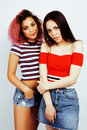 Lifestyle People Concept: Two Pretty Stylish Modern Hipster Teen Girl Having Fun Together, Diverse Nation Mixed Races Royalty Free Stock Photos - 93485888