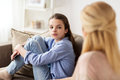 Sad Girl With Mother Sitting On Sofa At Home Stock Images - 93494484