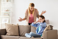 Girl Closing Ears To Not Hear Angry Mother At Home Stock Photography - 93494502