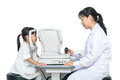 Asian Little Chinese Girl Doing Eyes Examination Through Auto Re Stock Photography - 93521292