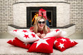 Beautiful Young Blonde Woman Lying On Pillow In The Room With Fireplace And Enjoy The Fire In The Fireplace. Pillows For Home Inte Stock Photography - 93544632