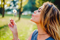 Girl In A Park Blowing Dandelion Royalty Free Stock Images - 93567619
