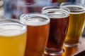 Closeup Of A Beer Flight On Wood Paddle Outside In Sunlight Stock Images - 93590894
