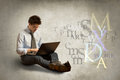 Young Man With Laptop Royalty Free Stock Photography - 93612317