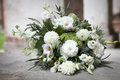 The Wedding Bouquet In White Tones Of Lisianthus, Roses, Dahlias And Eucalyptus Lying On Stone Ancient Pavement Stock Photography - 93648572