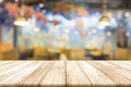 Empty Wooden Table Top With Blurred Restaurant Interior Backgrou Stock Photo - 93673300