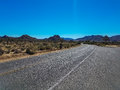 Road Through The Desert Of The Joshua Tree Park In California Royalty Free Stock Photography - 93702767
