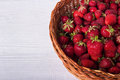 Wicker Basket Filled With Ripe Strawberries. On A White Wooden Background. Copy-space. Royalty Free Stock Photography - 93748377