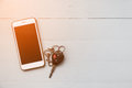 Mobile Phone And Car Remote Keys On Wooden Background Royalty Free Stock Photos - 93782388