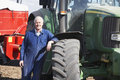 Driver Standing In Front Of Tractor Stock Photo - 9387960