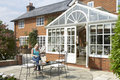 Exterior Of House With Conservatory And Patio Stock Images - 9388064