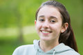 Portrait Of Smiling Pre Teen Girl Outdoors Stock Image - 93812381