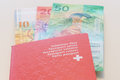 Swiss Passport And Swiss Francs With New 20 And 50 Swiss Franc Bills. Stock Photo - 93829940