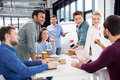 Professional Businesspeople Discussing And Brainstorming Together On Workplace In Office Stock Photos - 93873173