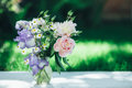 Bouquet Of White Peonies, Chamomiles And Iris Flowers In Glass Vase. Summer Background. Tinted Photo Stock Photos - 93887653
