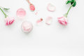 Cosmetic Set With Rose Blossom And Body Cream On White Desk Background Top View Mock-up Stock Photo - 93900430