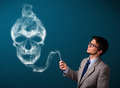 Young Man Smoking Dangerous Cigarette With Toxic Skull Smoke Stock Image - 93919271