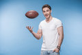 Young Man Playing With Rugby Ball And Smiling At Camera Stock Photography - 93936522