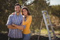 Portrait Of Young Couple Embracing At Farm Stock Images - 93964964