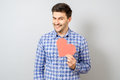 Portrait Of Smiling Man Holding Red Paper Pixel Heart Stock Photo - 93967320
