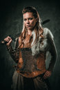 Viking Woman With Cold Weapon In A Traditional Warrior Clothes Stock Images - 93978904