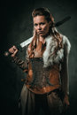 Viking Woman With Cold Weapon In A Traditional Warrior Clothes Stock Photos - 93978933
