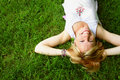 Relaxing Woman Laying On Grass Royalty Free Stock Photography - 941637