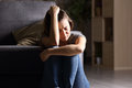 Sad Teen At Home In A Dark Living Room Stock Photography - 94016572
