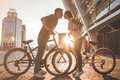 Romantic Couple With Bicycles In The City Stock Photo - 94016920