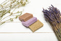 Homemade Soap Pile With Dried Lavender Bunch On Wooden Surface Stock Images - 94019424