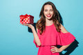 Happy Smiling Girl In Dress Holding Present Box And Winking Stock Images - 94022594