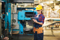 Pretty Technician Carrying Out Inspection Royalty Free Stock Photo - 94030515