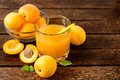 Fresh Apricot Juice And Apricots On Wooden Table. Stock Photography - 94033612