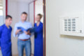 Entry System With Blurred Workers In Background Stock Photography - 94039352