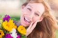 Excited Young Adult Brown Eyed Woman Holding Bouquet Of Flowers Stock Image - 94050751
