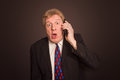 Shocking News. Surprised Mature Man In Suit With Mobile Phone Stock Photography - 94051462