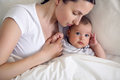 Mom With A Newborn Son Lying Royalty Free Stock Photos - 94091878