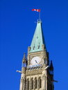 Flag Flying On Clock Tower Of Canadian Parliament Building In Ottawa, Ontario Stock Photos - 94155563