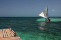 Wooden Pier And Sailing Ship, Tobacco Caye, Belize Stock Image - 94185351