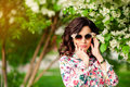 Girl In Sunglasses In A Blossoming Apple-tree Royalty Free Stock Images - 94187259