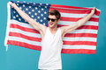 Handsome Man Holding USA Flag. Looking Aside. Royalty Free Stock Images - 94189199