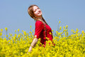 Happy Girl In Yellow Flowers Stock Photography - 9429482